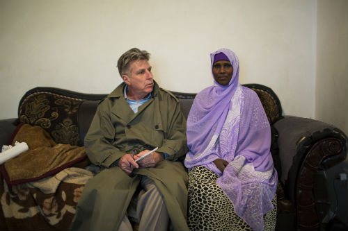 Minneapolis Star Tribune reporter Paul McEnroe speaks with Fadumo Hussein. This photo was taken a day after federal agents came to her home and arrested her youngest son, Guled Omar. Authorities say he was plotting with other young men to join ISIL. In 2007, another of Hussein's sons, Ahmed Ali Omar, left the U.S. as part of the first wave of Somali-Americans in the Twin Cities to fight for Al-Shabab. Photo: Renee Jones Schneider/Star Tribune